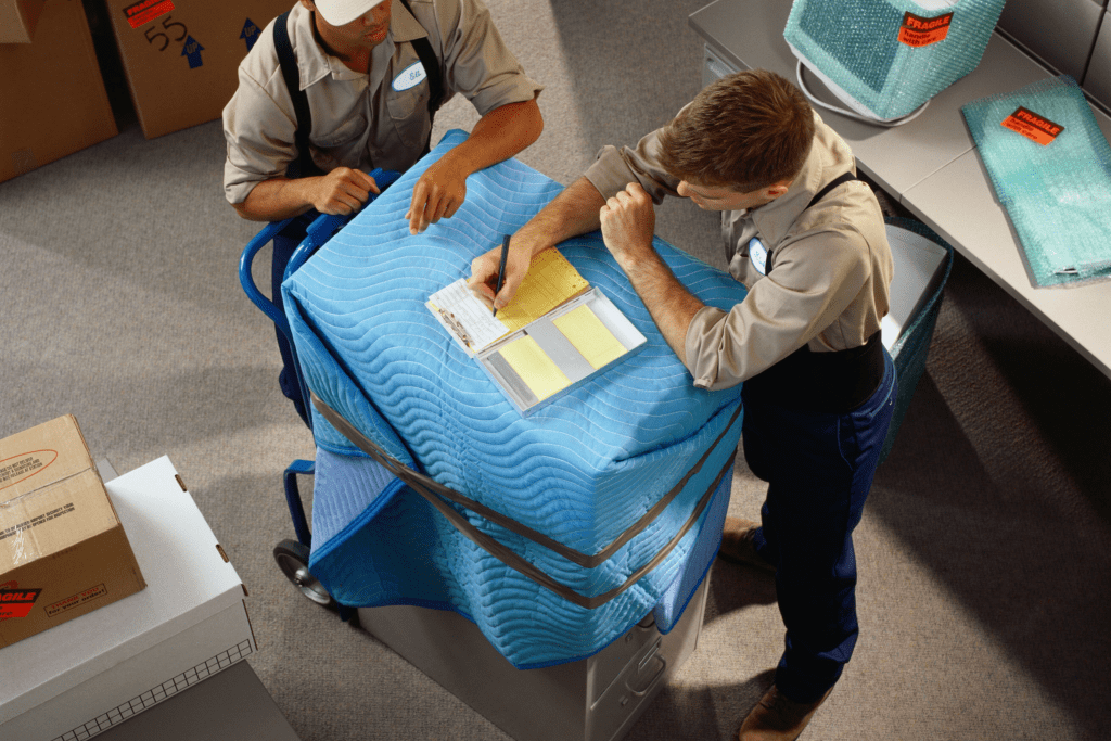 Movers Wrapping Office Furniture