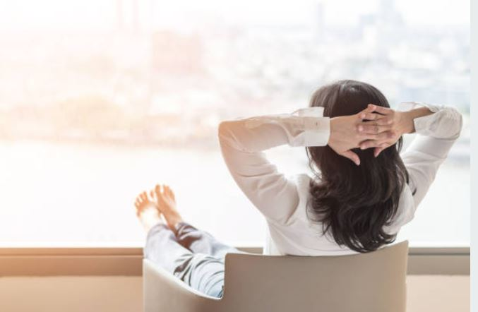 woman relaxing in new office