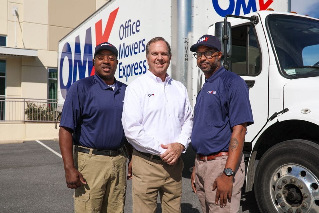 OMX moving team in front of truck