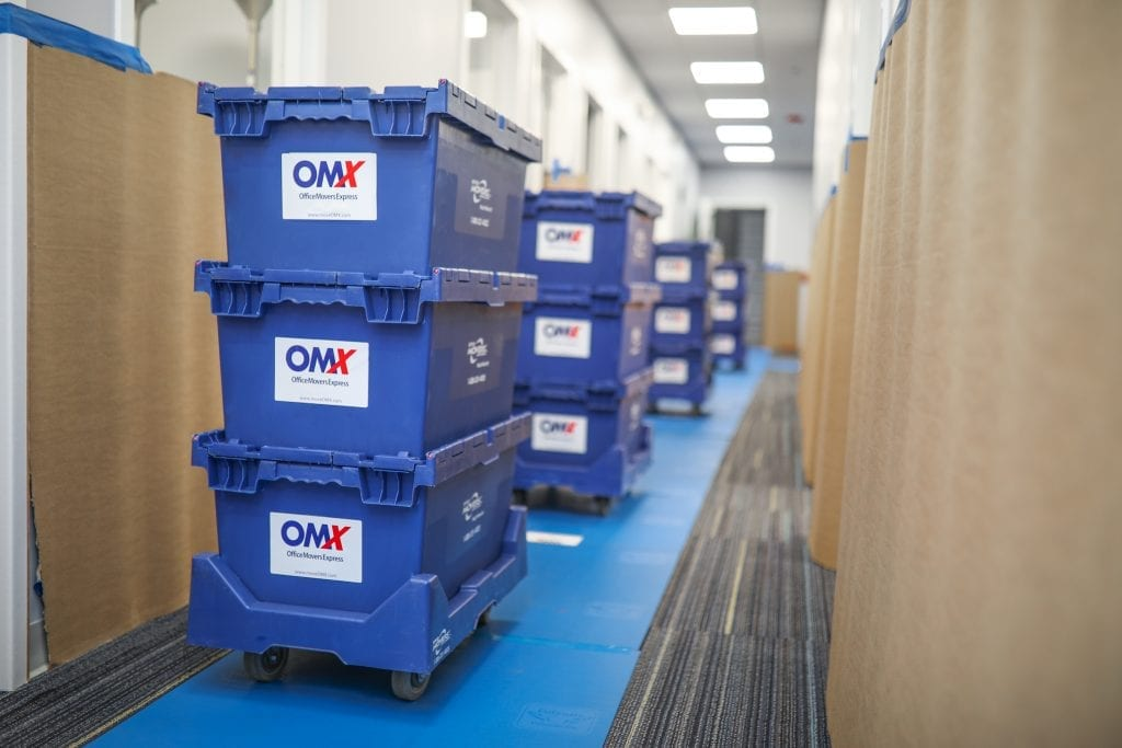 OMX moving crates in hallway