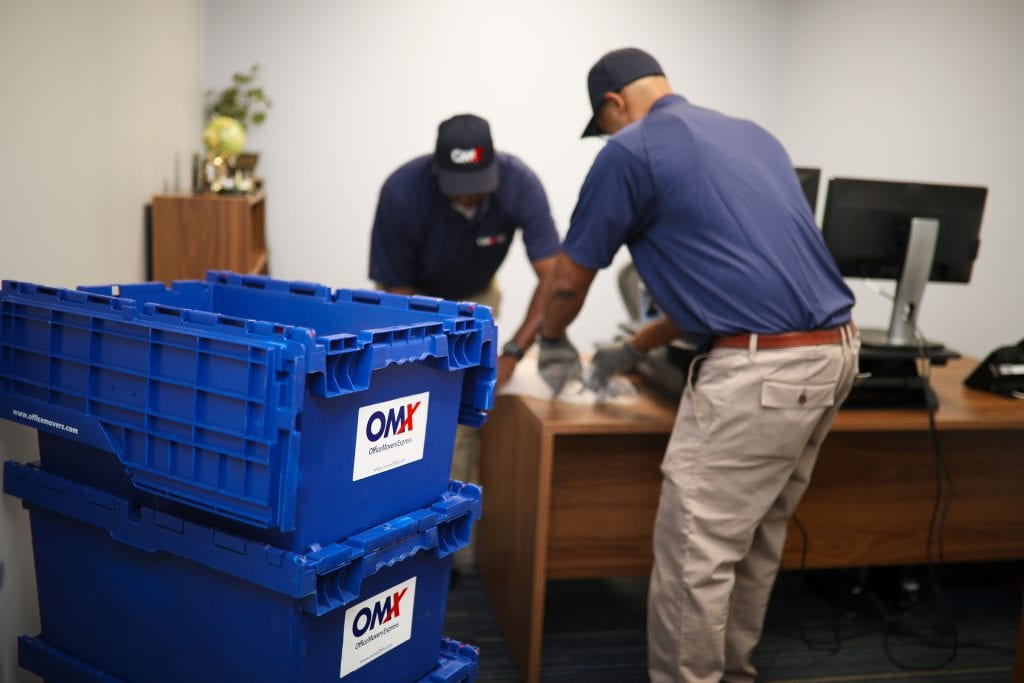 OMX movers packing up office