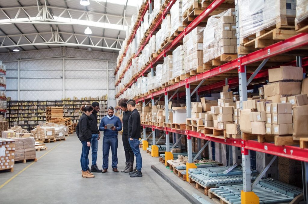 employees meeting in warehouse