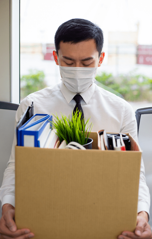 employee carrying moving box