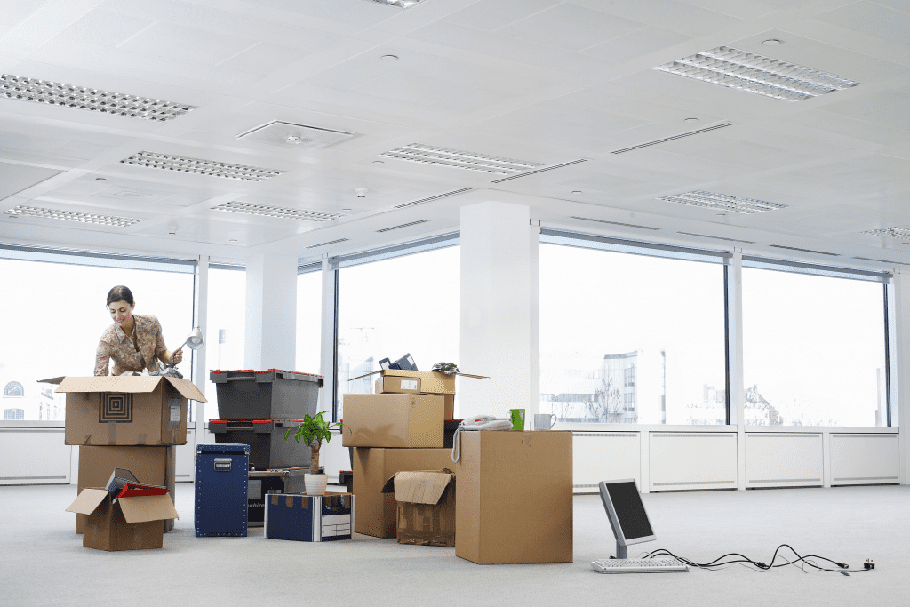 woman unpacking boxes in new office