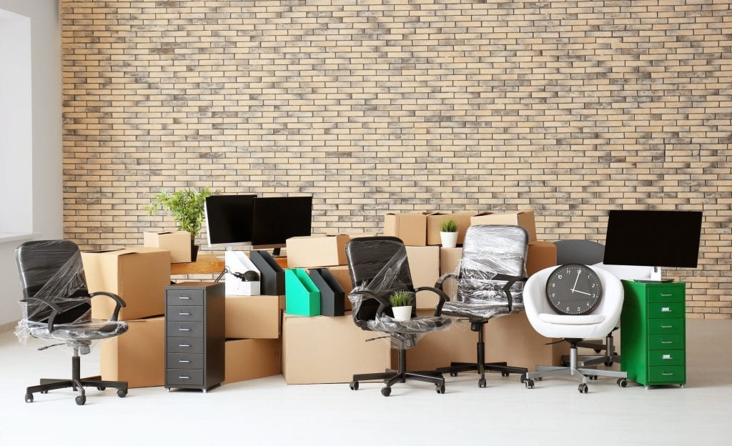 office filled with moving boxes
