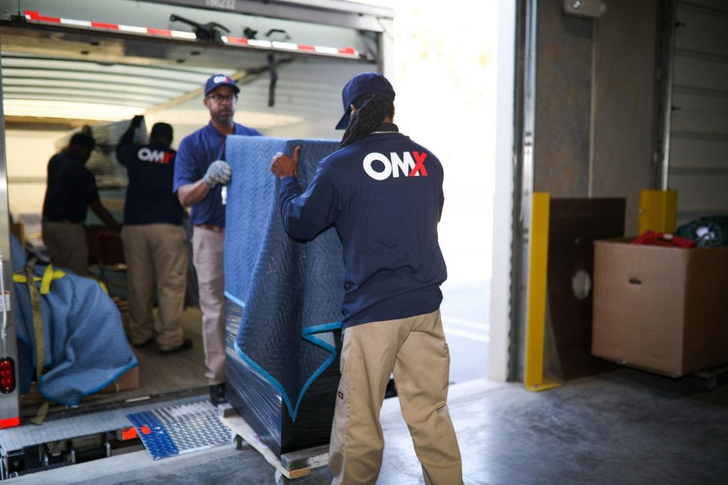 OMX movers off-loading truck